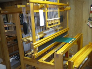 Loom threaded with damask, using drawloom shafts.