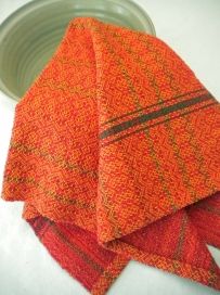 Tangerine and Reg Towel woven in point twill.