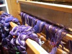 View from the front, warp chains threaded through the reed.